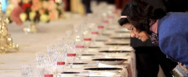 File pic of a visitor inspecting a dinner table at the presidential palace in 2008