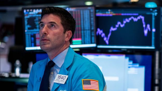 Un agente de bolsa en Wall Street.