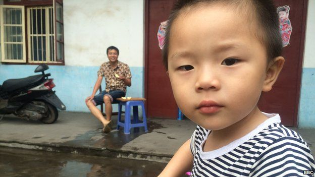 Chinese child with his father