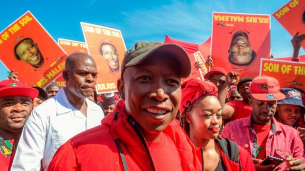 Economic Freedom Fighters (EFF) party leader Julius Malema walks away after casting his vote at a polling station in the Sheshego township on the outskirts of Polokwane on 8 May 2019.