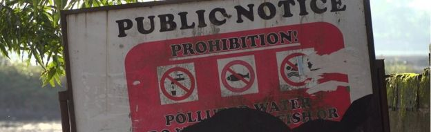 Sign warning about pollution