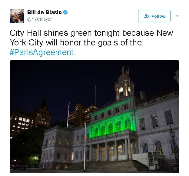 Tweet reads: City Hall shines green tonight because New York City will honor the goals of the #ParisAgreement.