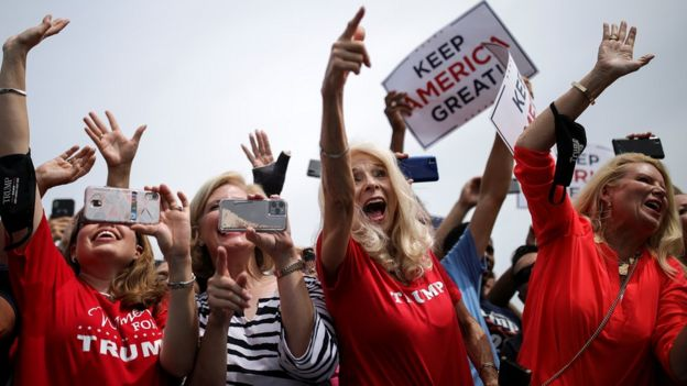 Supporters cheer for Mr Trump during his visit to North Carolina