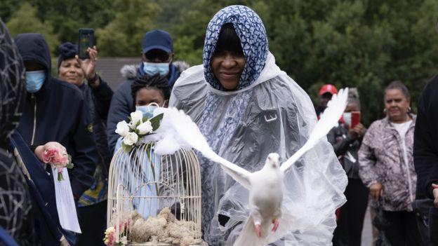 Alina Joseph releasing a dove