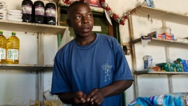 Solomon Chakauya, waits for customers in his grocery store, in Chinamhora district north-east of Zimbabwe's capital Harare on December 10, 2018.