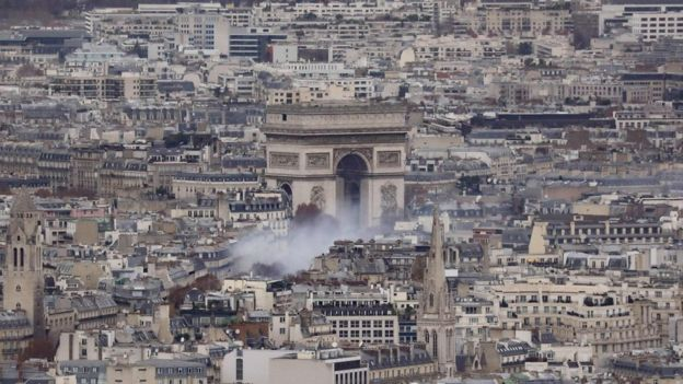 Aerial view showing smoke rising near the Arc de Triomphe