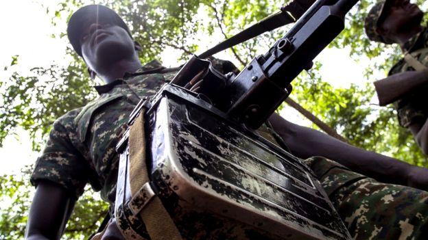 Ugandan soldier with gun