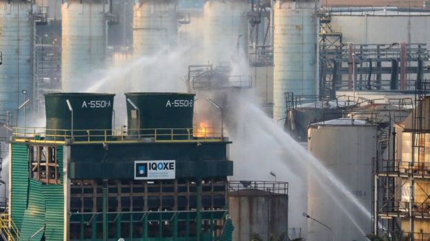 Firefighters spray water after a large fire broke out at the chemical factory in Tarragona, Spain, 15 January 2020