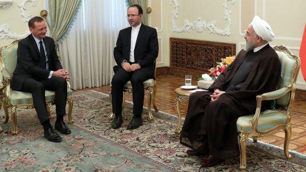 French envoy Emmanuel Bonne (L) speaks to Iranian President Hassan Rouhani in Tehran on 10 July 2019