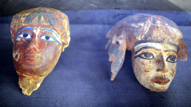 Painted wooden masks on display at a tomb at Draa Abul Naga necropolis on Luxor, Egypt, 9 December 2017