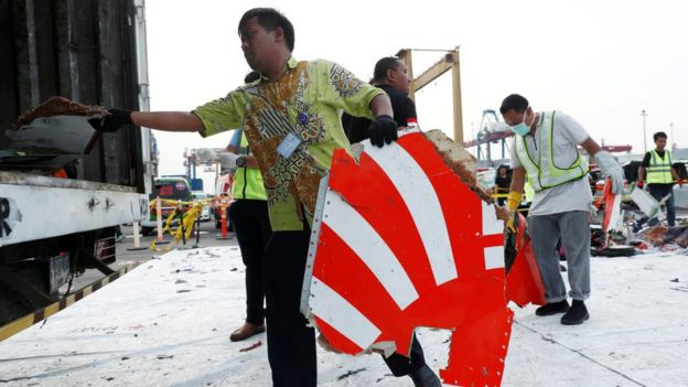 Workers load up recovered debris and belongings believed to be from Lion Air flight JT610 onto a truck at Tanjung Priok port in Jakarta
