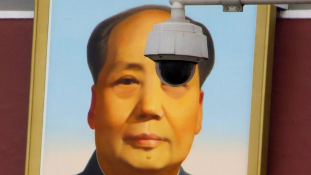 A security camera overlooks Tiananmen Square in front of a portrait of the late Chinese Chairman Mao Zedong in Beijing, China on 6 March 2018.