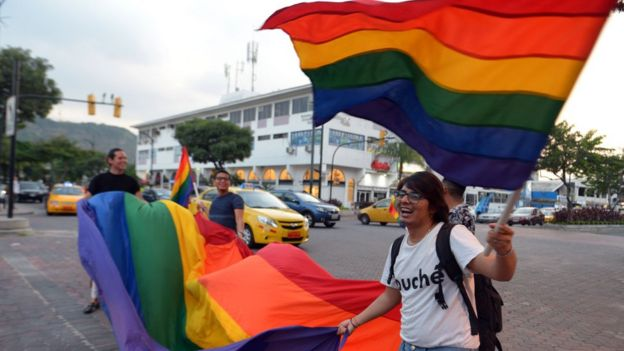 People celebrate after the Ecuador's Constitutional Court approved equal civil marriage, in Guayaquil, Ecuador