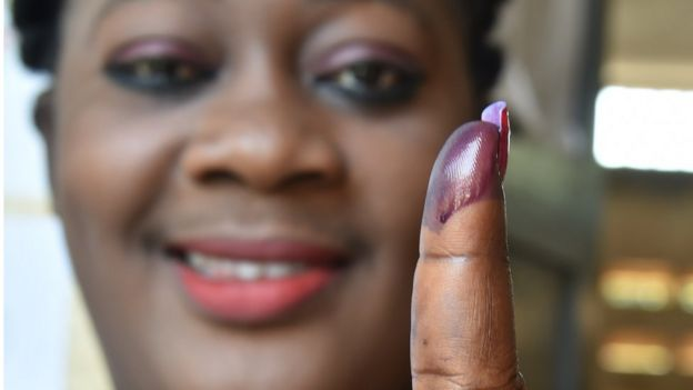 Togolese woman with ink on her finger after election
