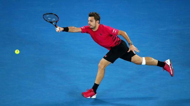 Stan Wawrinka of Switzerland plays a forehand in his semifinal match against Roger Federer of Switzerland on day 11 of the 2017 Australian Open at Melbourne Park on January 26, 2017 in Melbourne, Australia.