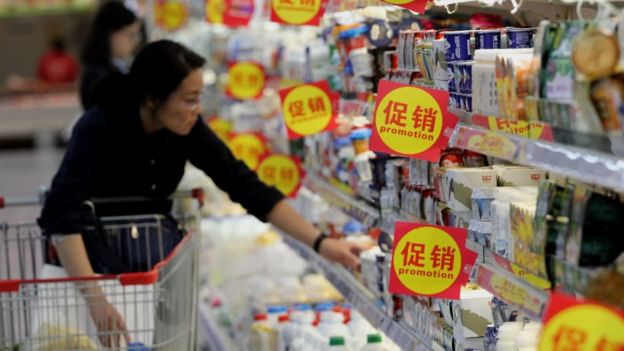 Woman in China shopping for dairy products
