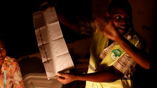An Independent Electoral and Boundaries Commission (IEBC) official shows a ballot paper during vote counting at the end of the presidential election in Mombasa, Kenya August 8, 2017.