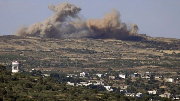 Smoke rises after bombardment of hill next to Druze town of Hadar, in Syria's Quneitra province (17 June 2015)