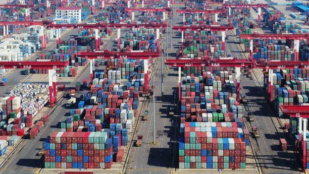 Containers sit stacked at Qingdao Port at Qingdao, Shandong Province of China