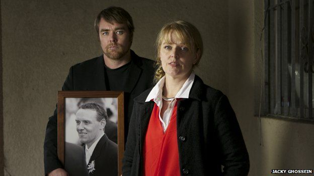 Shivaun Deacon and her brother Amon Leis with a photo of their brother Ivahn Leis