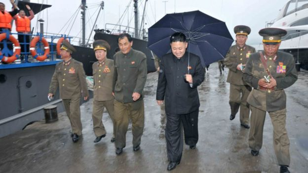Kim Jong-un walks past a lauxury yacht during a 2013 inspection visit