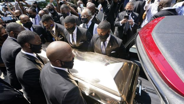 George Floyd's body is loaded into a hearse in Houston, 9 June
