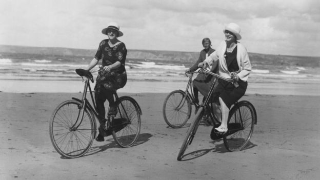 Group of women cycling on the beach in 1923