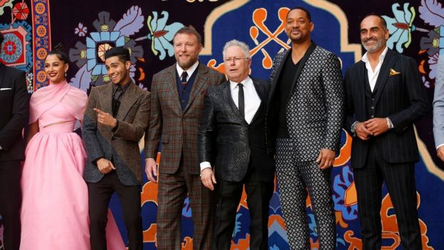(L-r) Naomi Scott, Mena Massoud, Guy Ritchie, Alan Menken, Will Smith and Navid Negahban attend the world premiere of Aladdin in Los Angeles