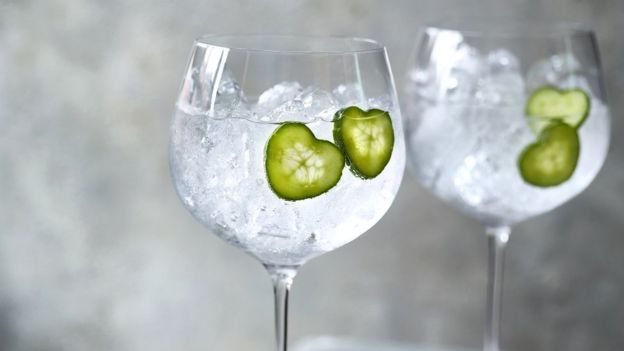 Heart-shaped cucumber slices in drink