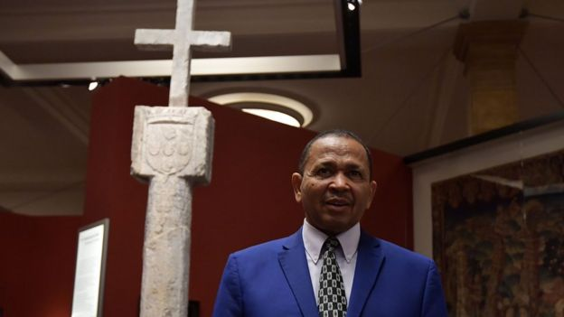 Namibia's Ambassador to Germany Andreas Guibeb posing with the Stone Cross