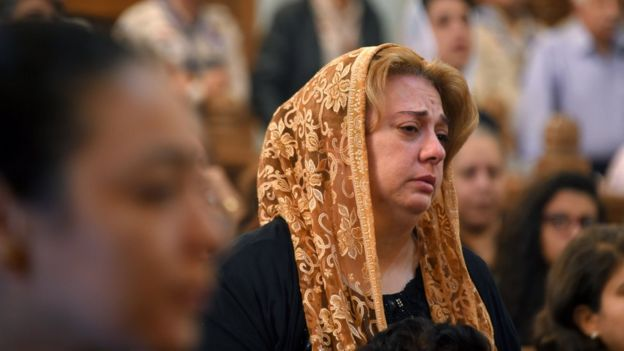 A Coptic Christian woman mourns victims killed in an attack a day earlier, during an early morning ceremony at the Prince Tadros church in Egypt