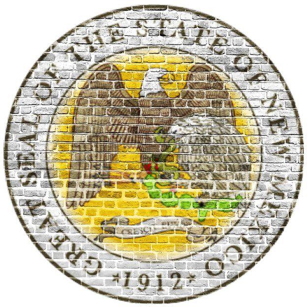 Escudo de Nuevo México de 1912 pintado en una pared