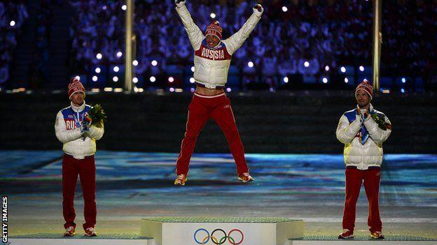 Vylegzhanin and Maxim Legkov celebrate winning Sochi medals