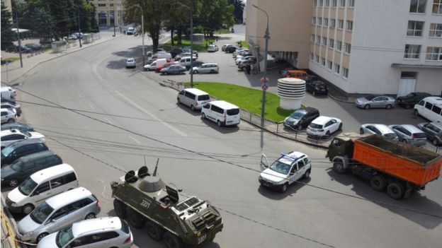 An armoured personnel carrier and other vehicles block a road during a hostage rescue operation following the seizure of a passenger bus in the city of Lutsk, Ukraine July 21, 2020