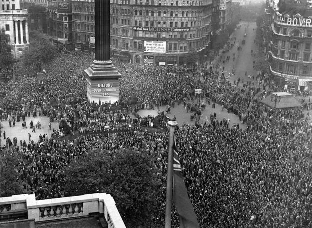 VE day, held to commemorate the official end of World War II in Europe, is celebrated by crowds at Trafalgar Square in London, 8th May 1945.