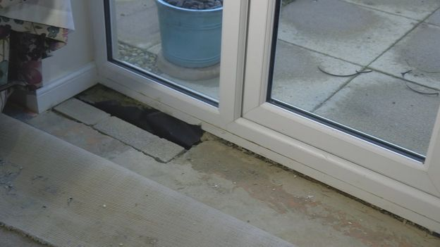 The hole next to the patio door
