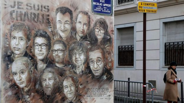 """Artwork by French street artist Christian Guemy (aka """"C215"""") depicting members of satirical magazine Charlie Hebdo painted on a facade near the magazine's offices at Rue Nicolas Appert, 7 January 2020"""