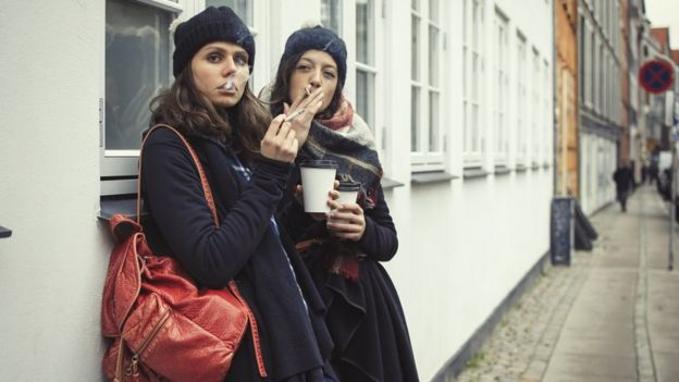 Women smoking and having coffee