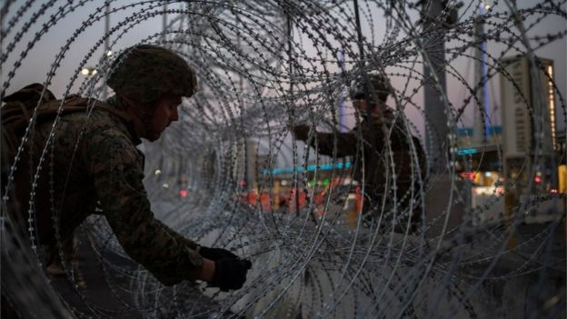 United States Marines fortify concertina wire along the San Ysidro Port of Entry border crossing as seen from Tijuana, Mexico November 20, 2018