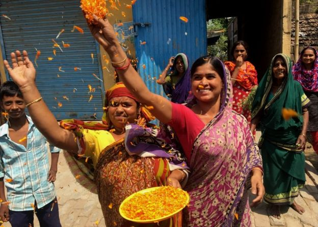 Women throw marigold petals at Mahua Moitra