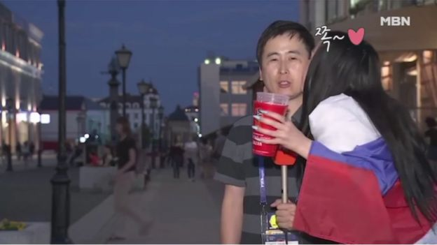 Jeon Gwang-ryeol being kissed by another Russian fan during live TV broadcast