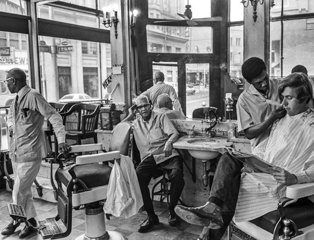 An all-white barber shop run by all-black barbers in downtown Atlanta, 1970