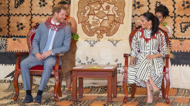 Prince Harry and Meghan at an exhibition of Tongan handicrafts