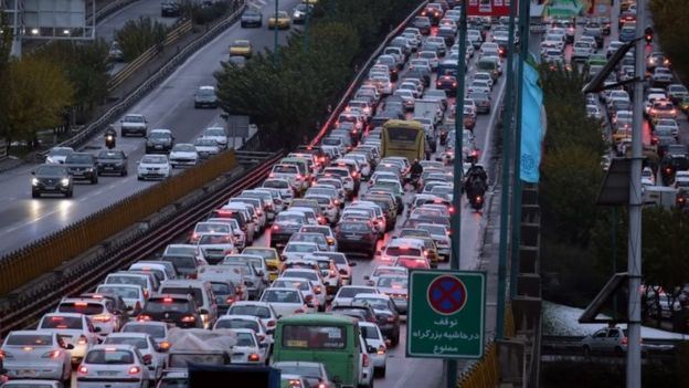 A highway is blocked by vehicles as protests block the roads following fuel price increase in Tehran, Iran