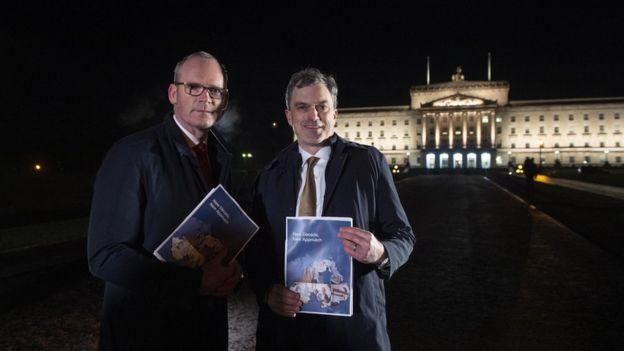 Julian Smith (R) and Irish Tanaiste Simon Coveney