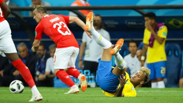 Brazilian footballer Neymar on the floor following a tackle