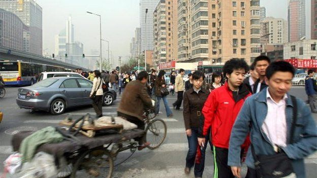 people rushing to work in Beijing