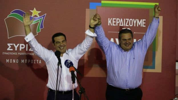Alexis Tsipras on stage with Panos Kammenos of the Independent Greeks