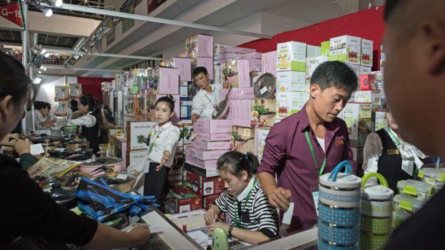 North Korea stallholders at the Pyongyang trade fair, September 2017