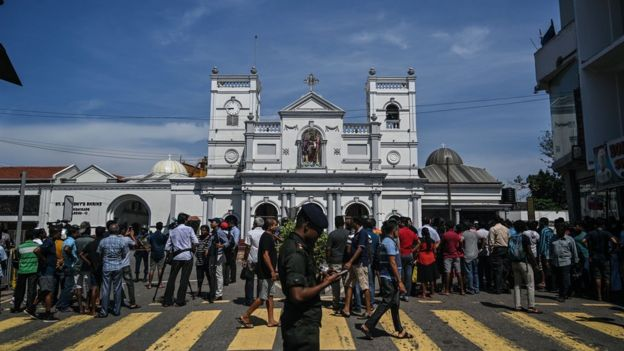 "Local residents gather outside the St. Anthony""s Shrine in Colombo on April 22, 2019,"